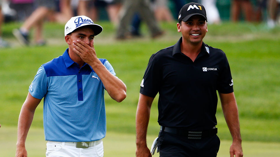 Rickie Fowler and Jason Day walk the fairway during the first round of the 2015 BMW Championship.
