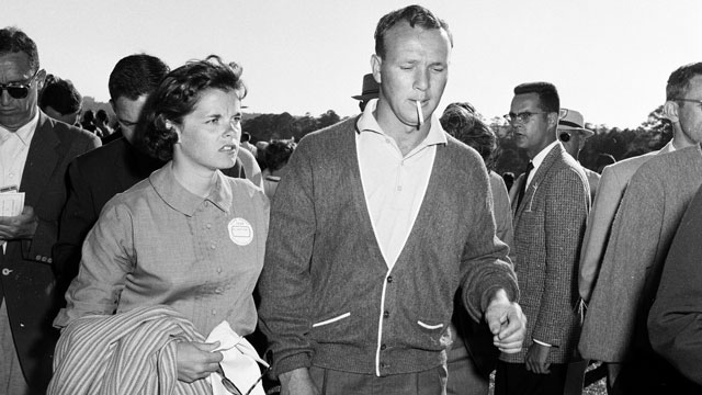 Arnold Palmer and his wife, Winnie, leaving the course during the 1959 Masters Tournament at Augusta National.