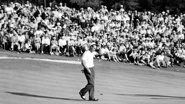 Arnold Palmer tips his hat to the gallery of patrons on the 18th green during the 1958 Masters Tournament at Augusta National.