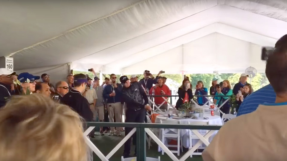Jason Kokrak takes his shot from a hospitality tent Friday at the Wells Fargo Championship.