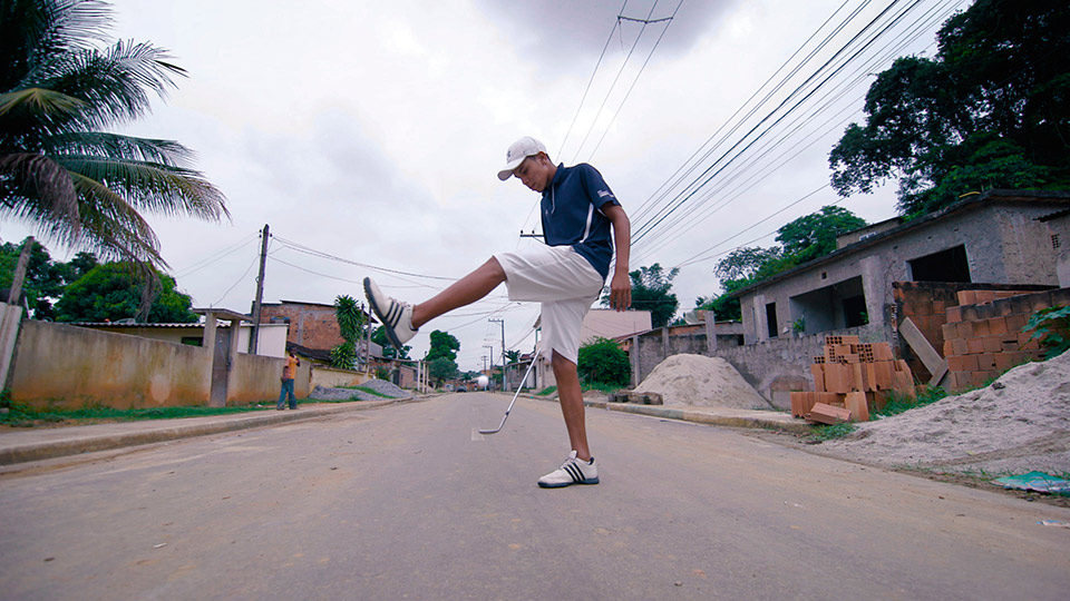 Breno Domingos shows off on the street where he grew up in Japeri, Brazil.