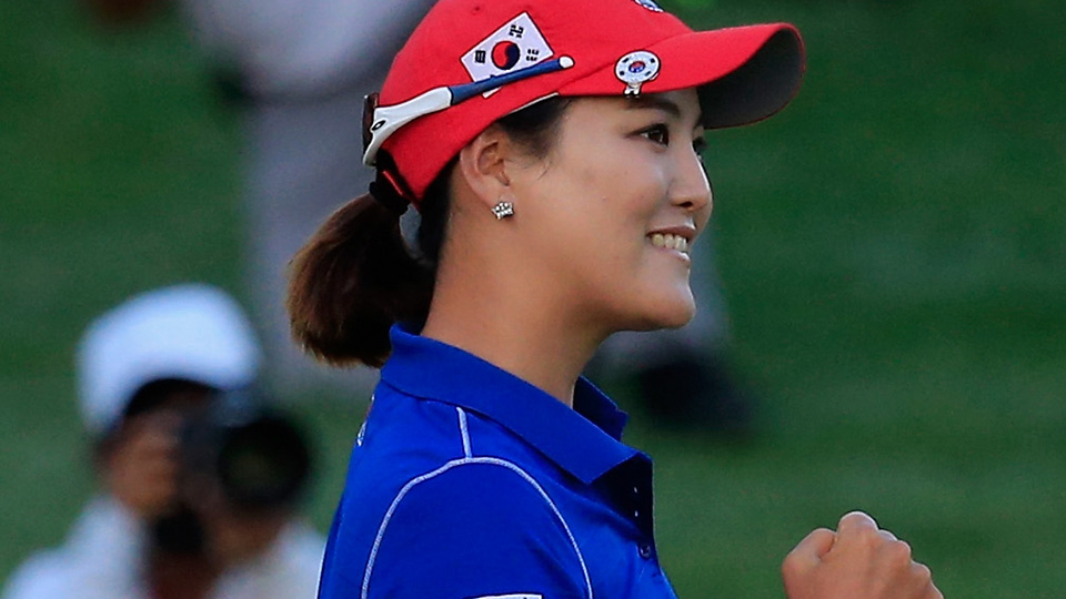 So Yeon Ryu of South Korea celebrates after sinking a putt on the 16th green to defeat the United States in a playoff during round three of the 2014 International Crown.