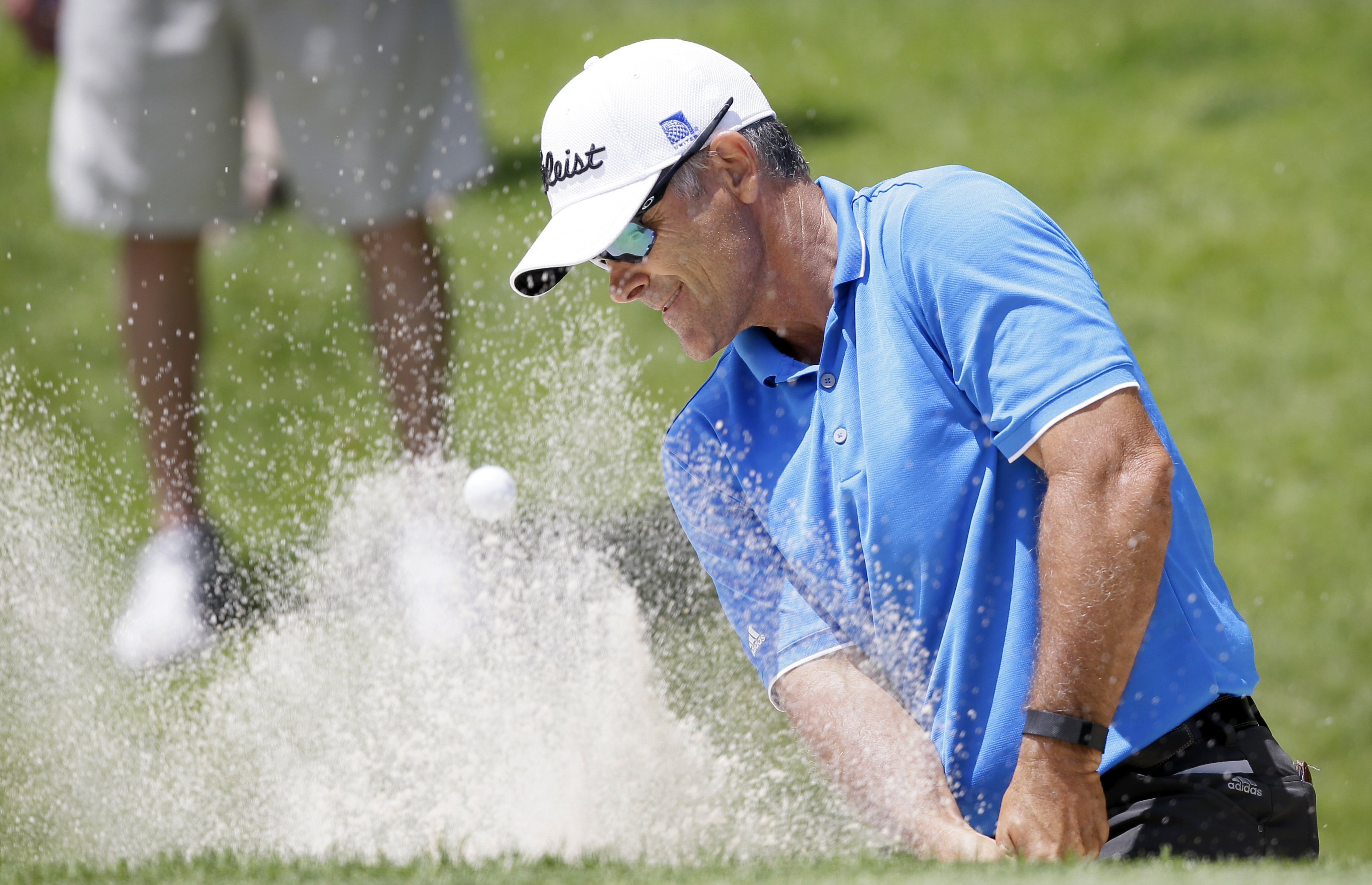 Tom Byrum hits out of a bunker onto the ninth green during the second round of the PGA Tour Champions Principal Charity Classic golf tournament, Saturday, June 4, 2016, in Des Moines, Iowa. (AP Photo/Charlie