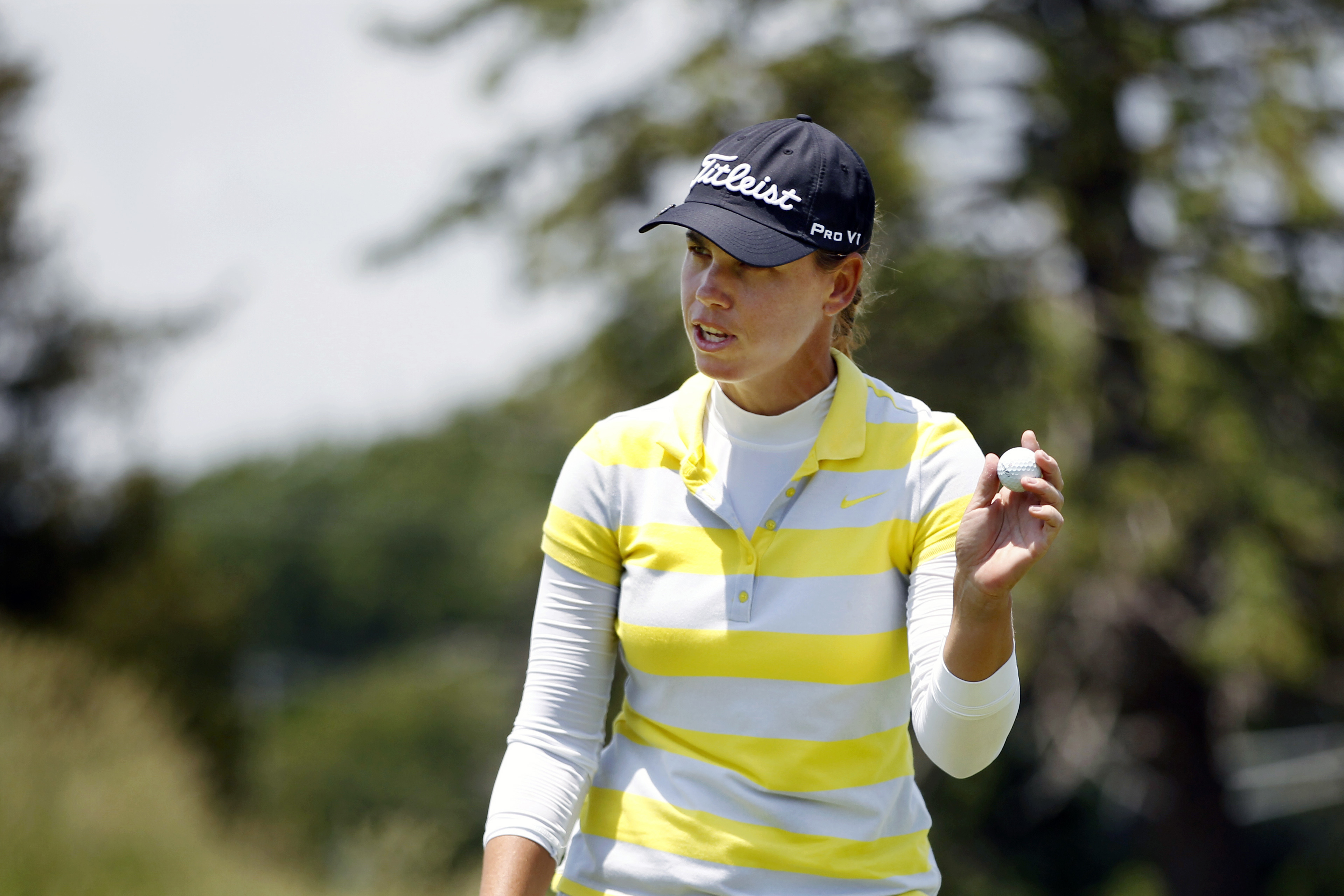 Karine Icher, of France, holds up her ball on the ninth hole of the second round of the ShopRite LPGA Classic golf tournament, Saturday, June 4, 2016, in Galloway Township, N.J.(AP Photo/Mel