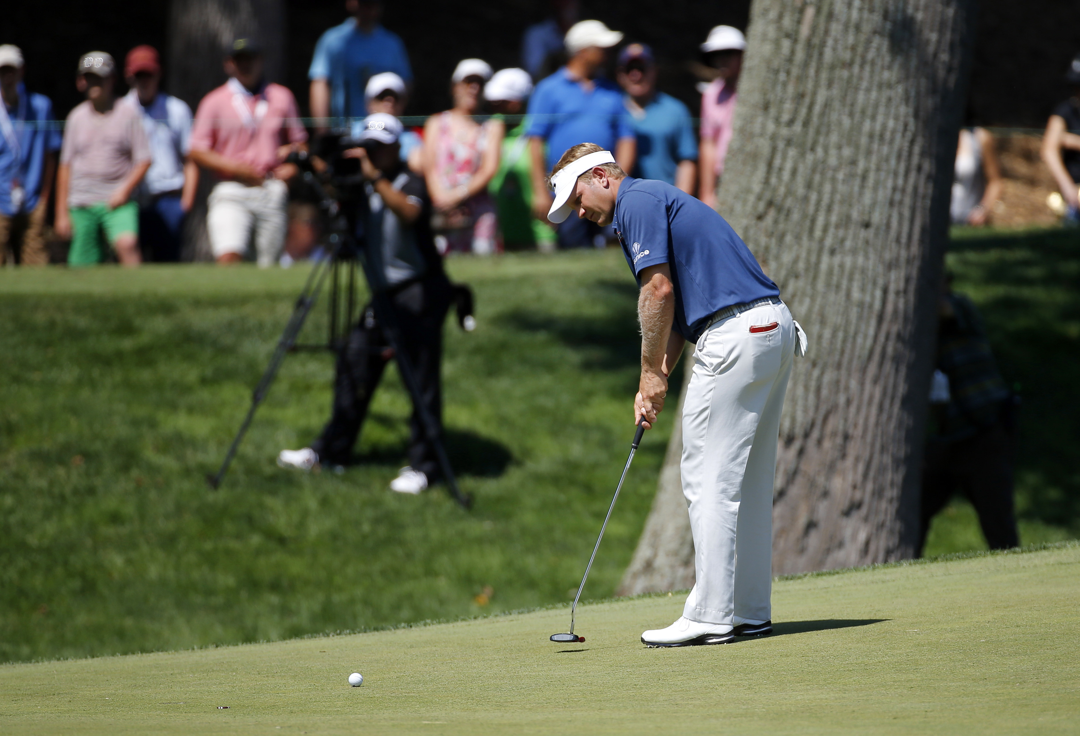 Billy Hurley III putts on the sixth green during the third round of the Quicken Loans National PGA golf tournament, Saturday, June 25, 2016, in Bethesda, Md. (AP Photo/Patrick