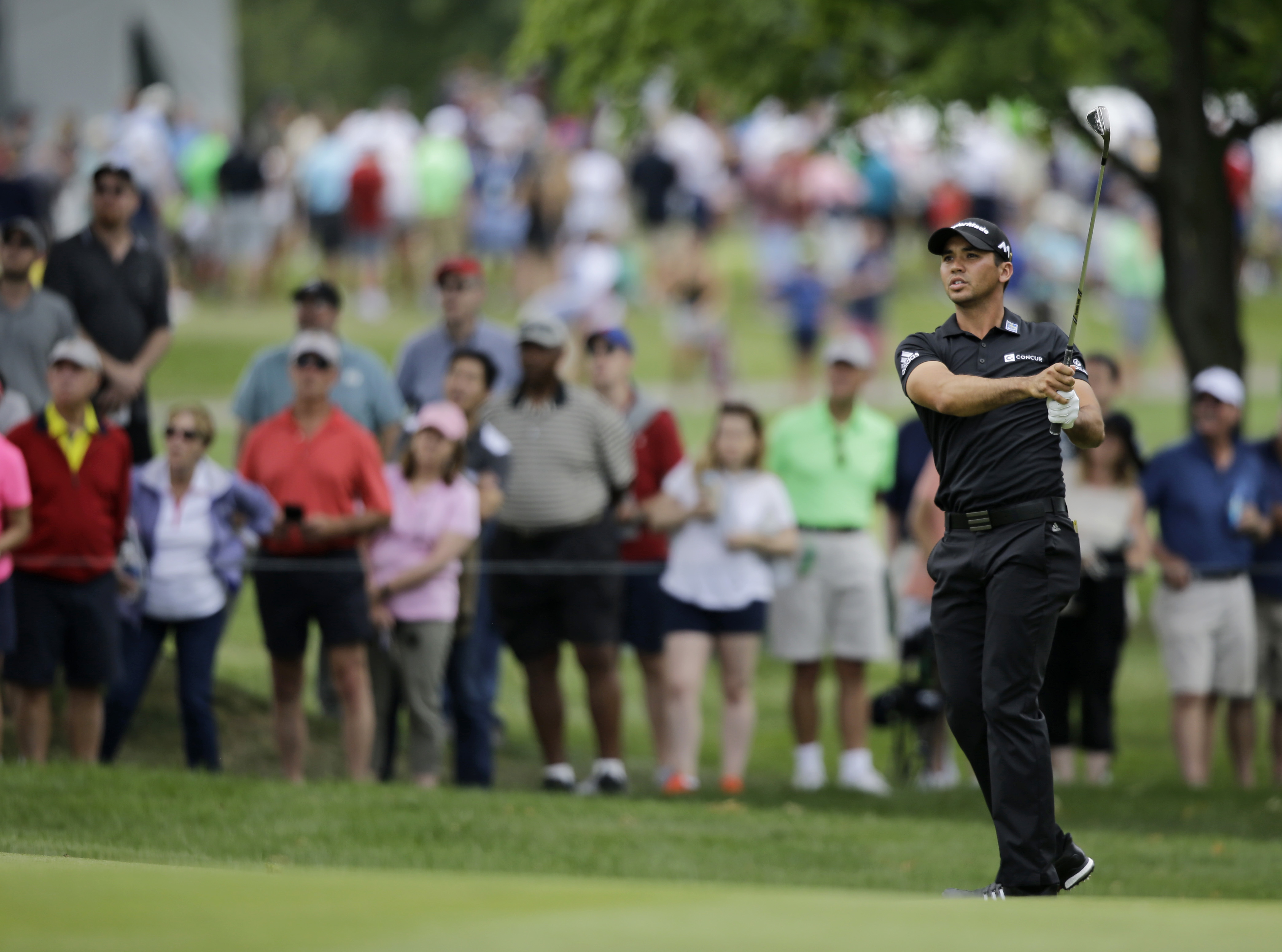 Jason Day hits to the second green during the third round of the Bridgestone Invitational at Firestone Country Club.