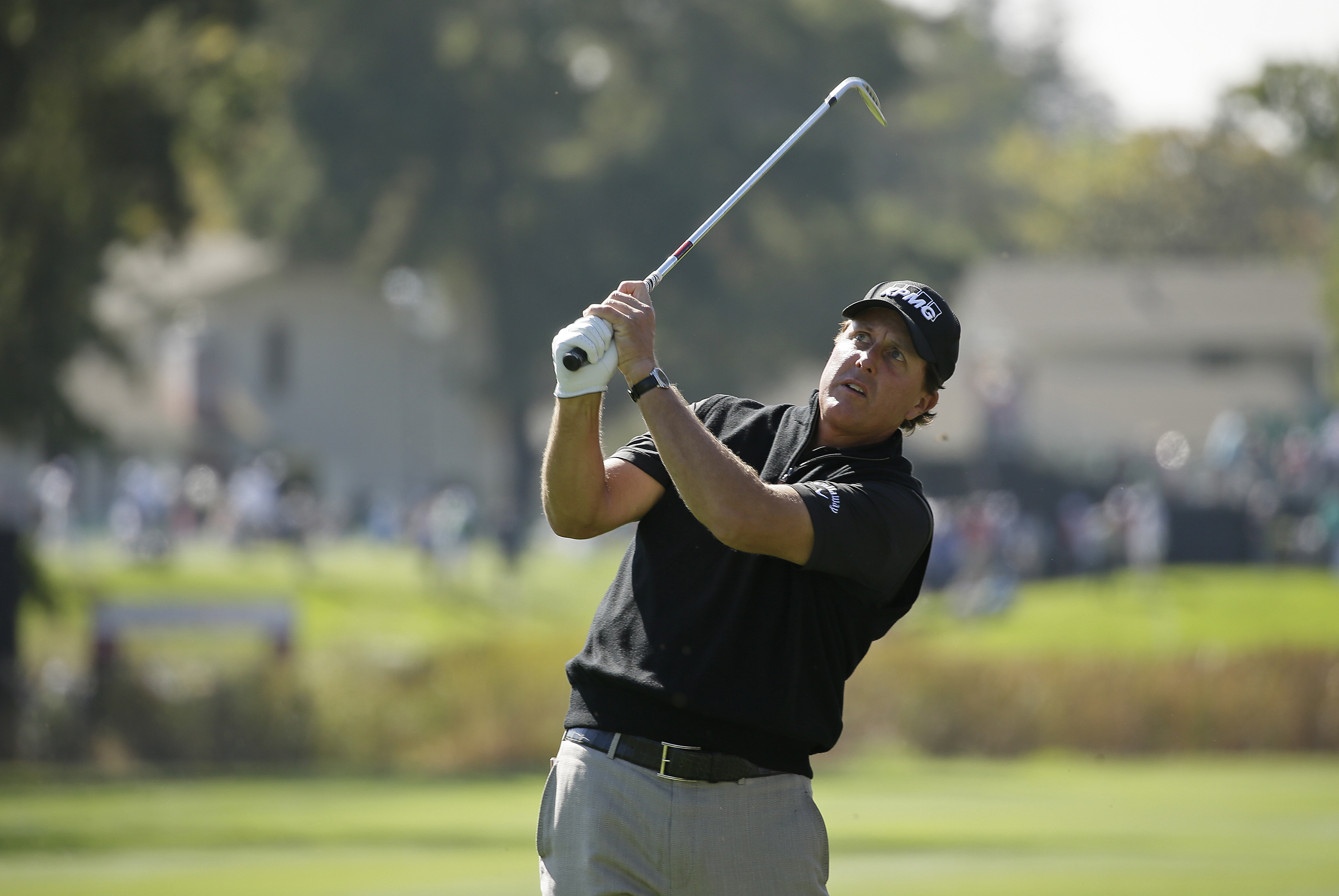 Phil Mickelson follows his approach shot at the Safeway Open.