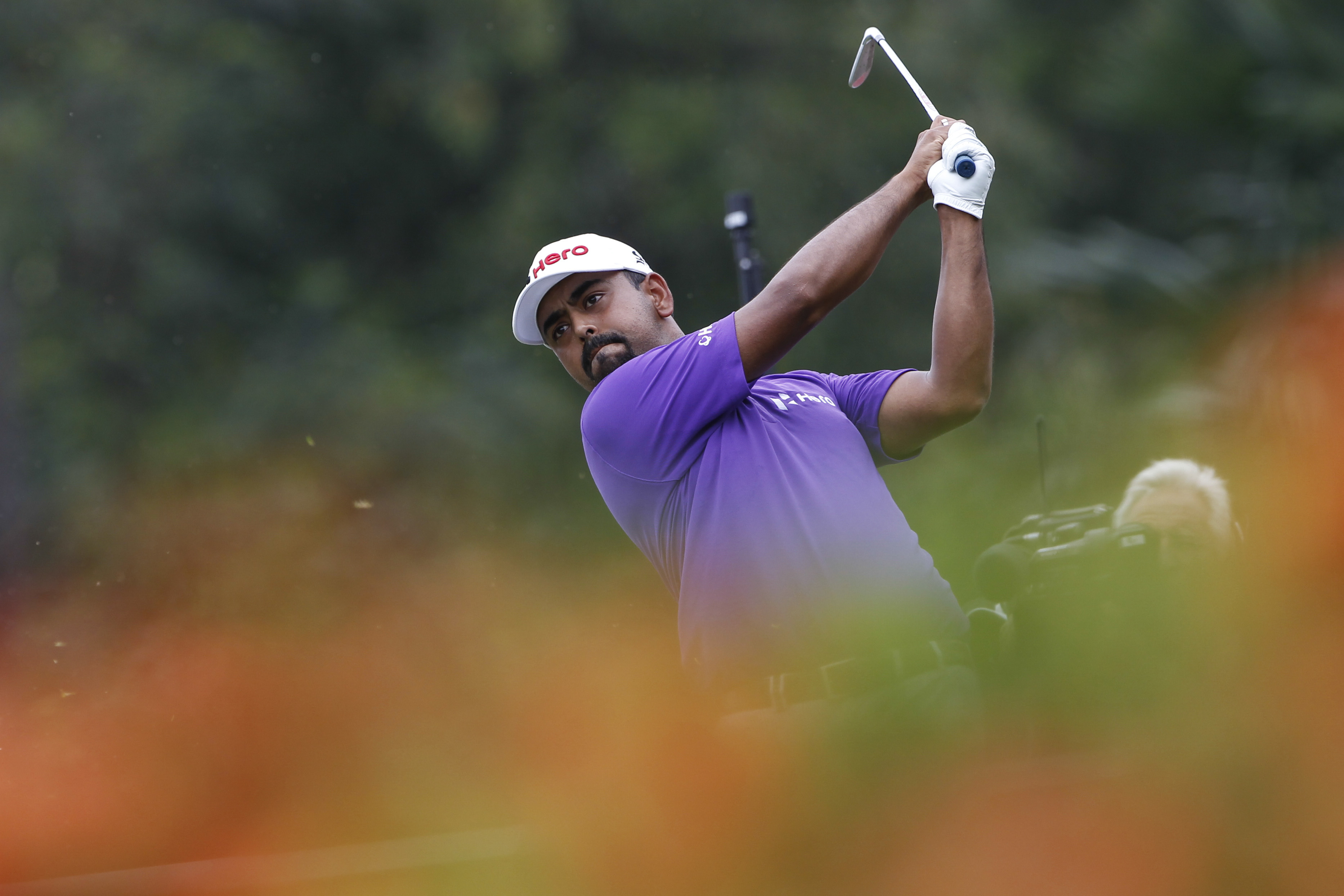 Anirban Lahiri of India follows his shot on the eighth hole during the third round of the CIMB Classic.