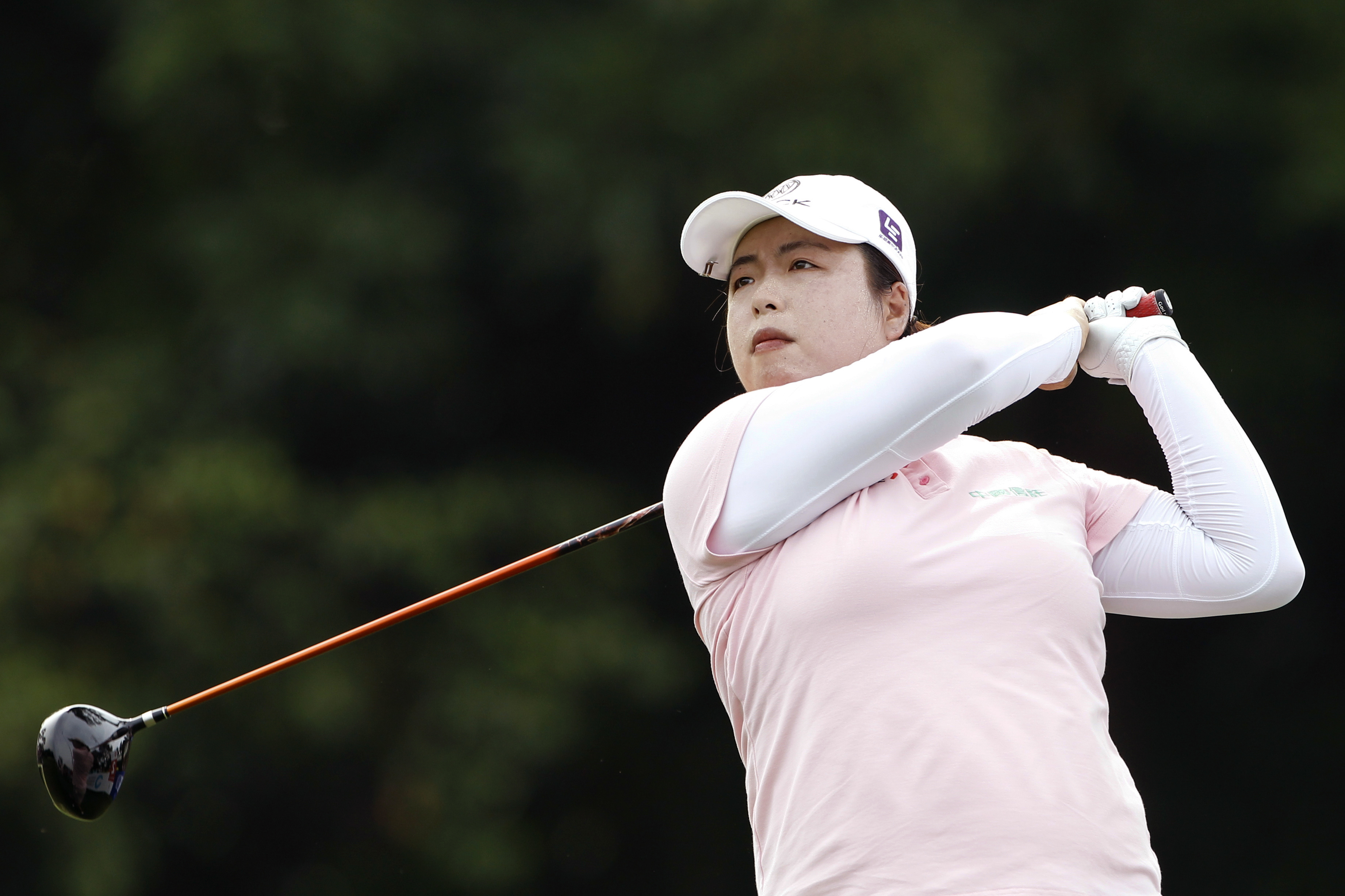 Shanshan Feng of China follows her shot during the third round of the Sime Darby LPGA.