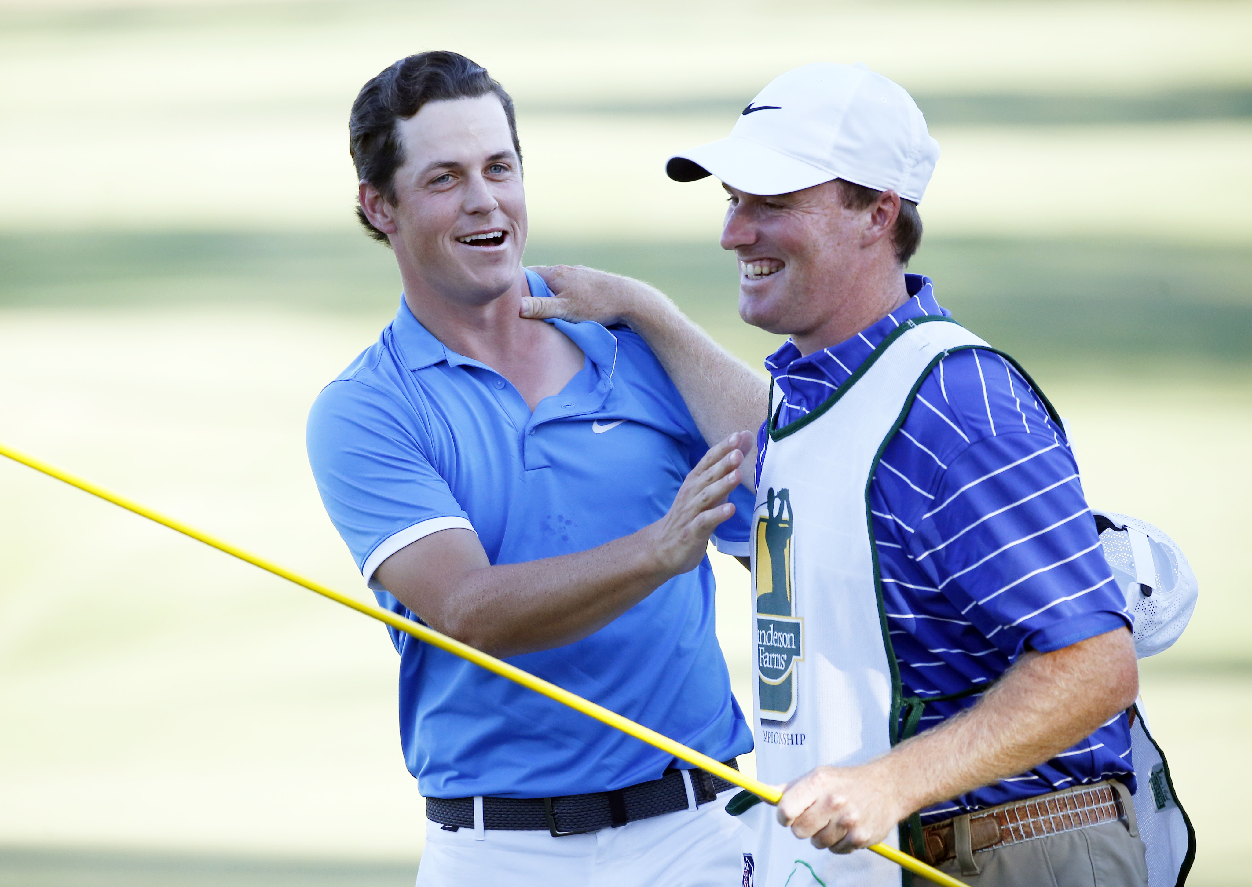 Cody Gribble and his caddie Bobby Hudson celebrate Gribble's winning of the Sanderson Farms Championship.