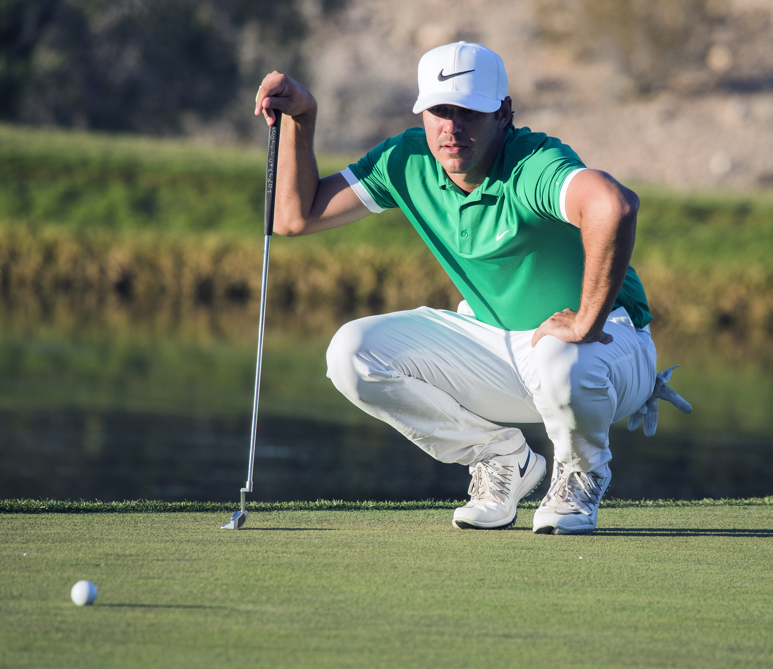 Brooks Koepka lines his putt on the 17th hole during the second round of the Shriners Hospitals for Children Open golf tournament Friday, Nov. 4, 2016, in Las Vegas.