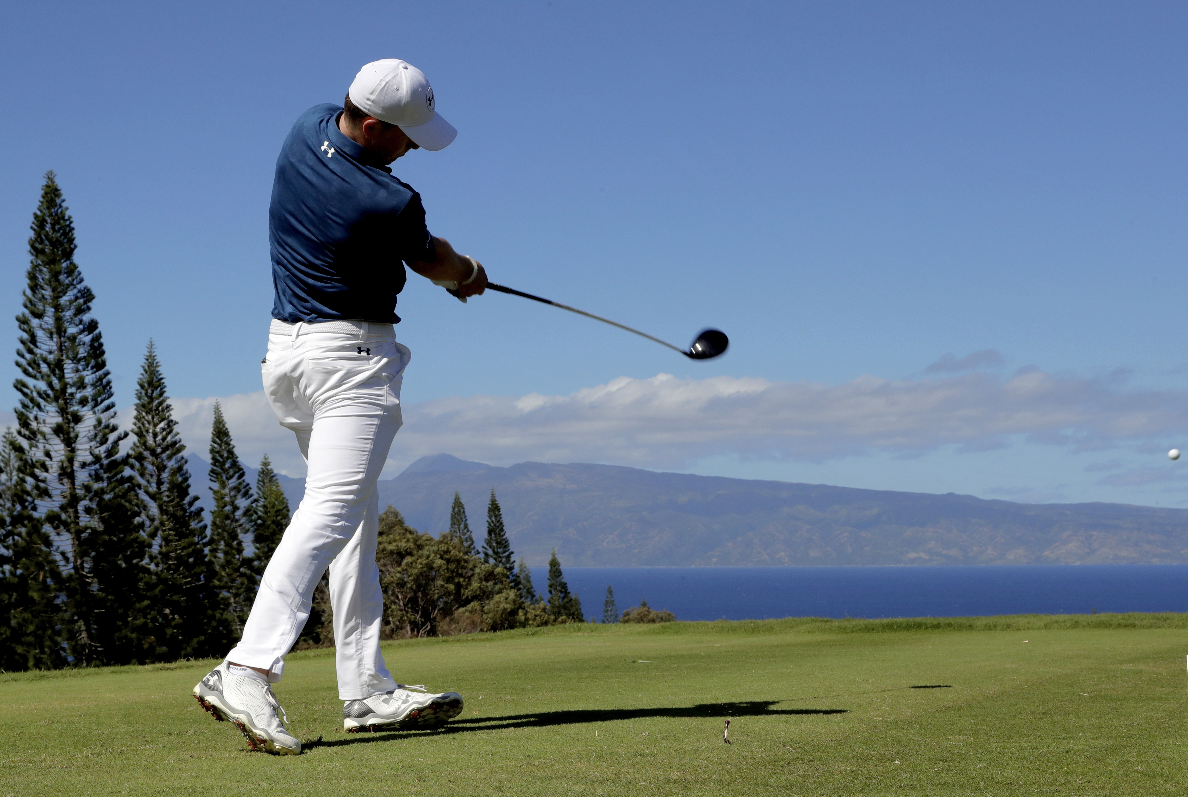 Jordan Spieth hits from the 18th tee during the final round of the Tournament of Champions golf event, Sunday, Jan. 8, 2017, at Kapalua Plantation Course in Kapalua, Hawaii. (AP Photo/Matt