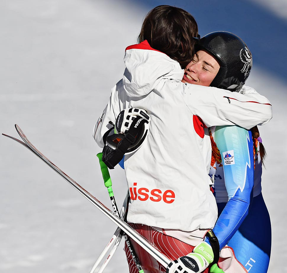 Tina Maze and Dominique Gisin celebrate after winning gold.
