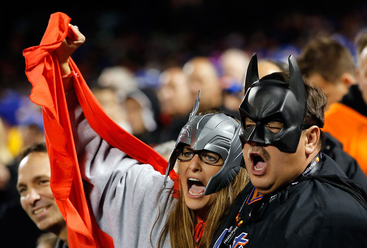 Mets fans celebrate during Game 4, which fell on Halloween night.