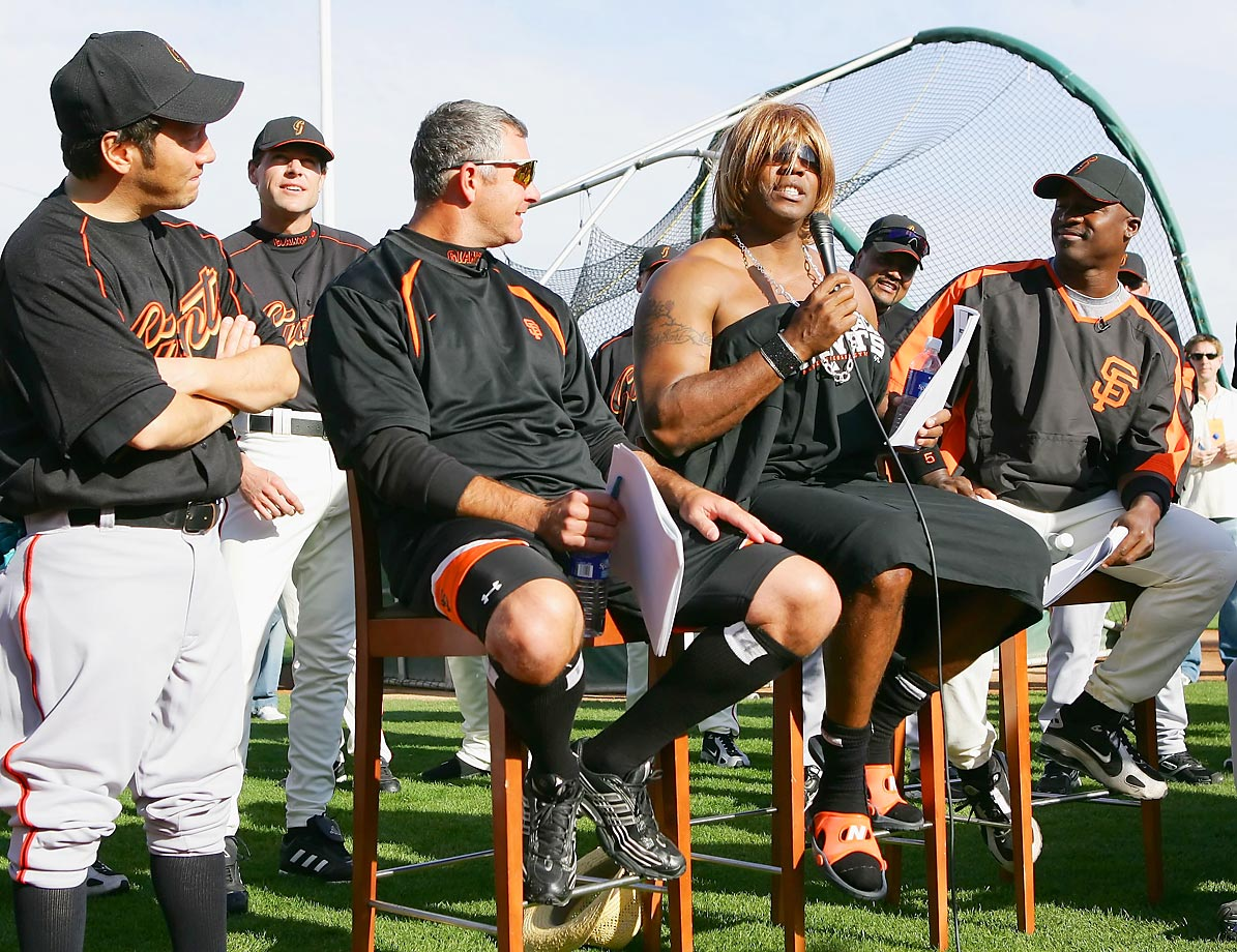 Actor Rob Schnieder (left) stands with Jeff Fassero, Ray Durham, and Barry Bonds who's portraying Paula Abdul.