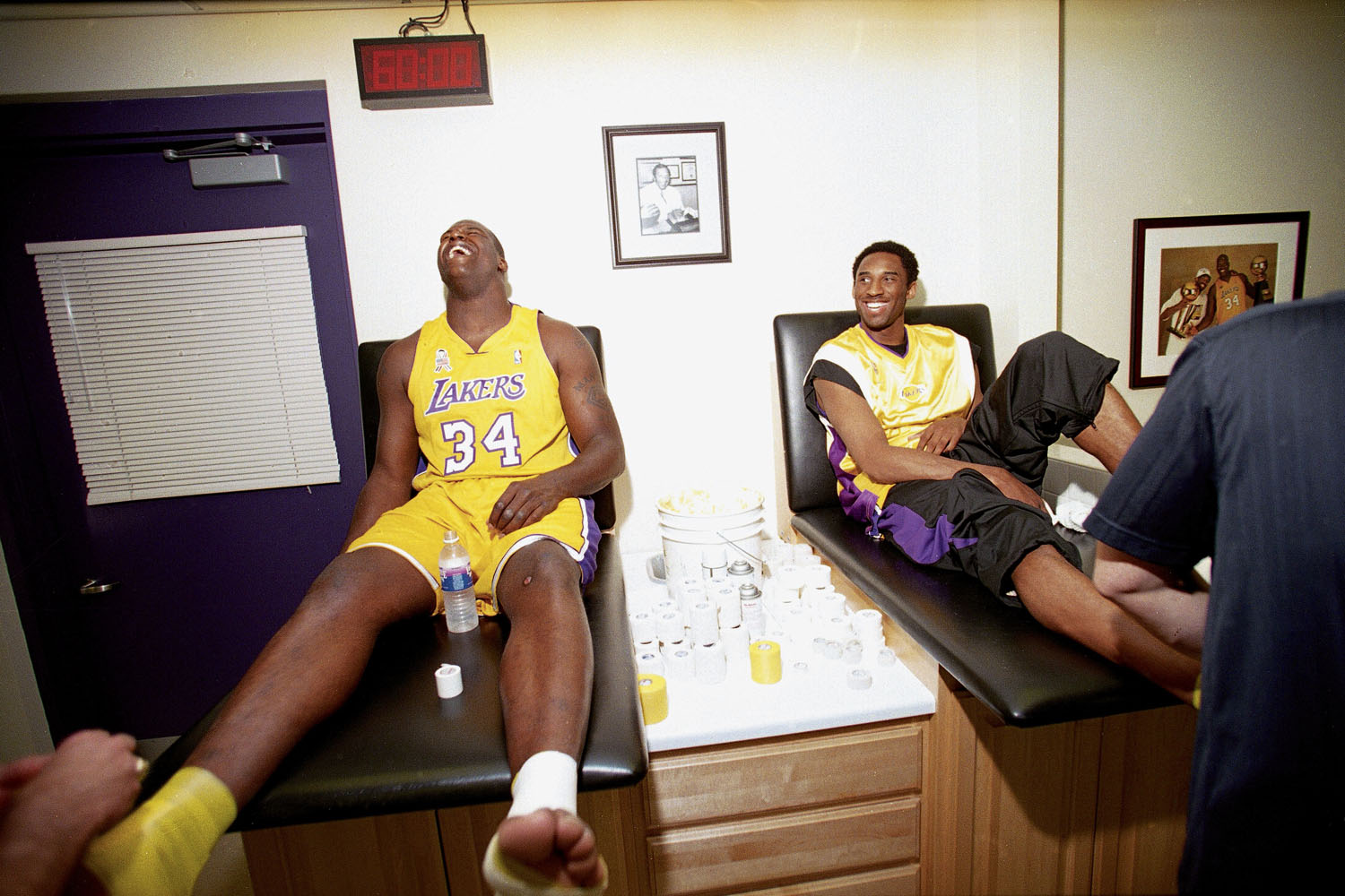 Shaquille O'Neal and Kobe Bryant with trainer before a home game in Los Angeles in 2002.