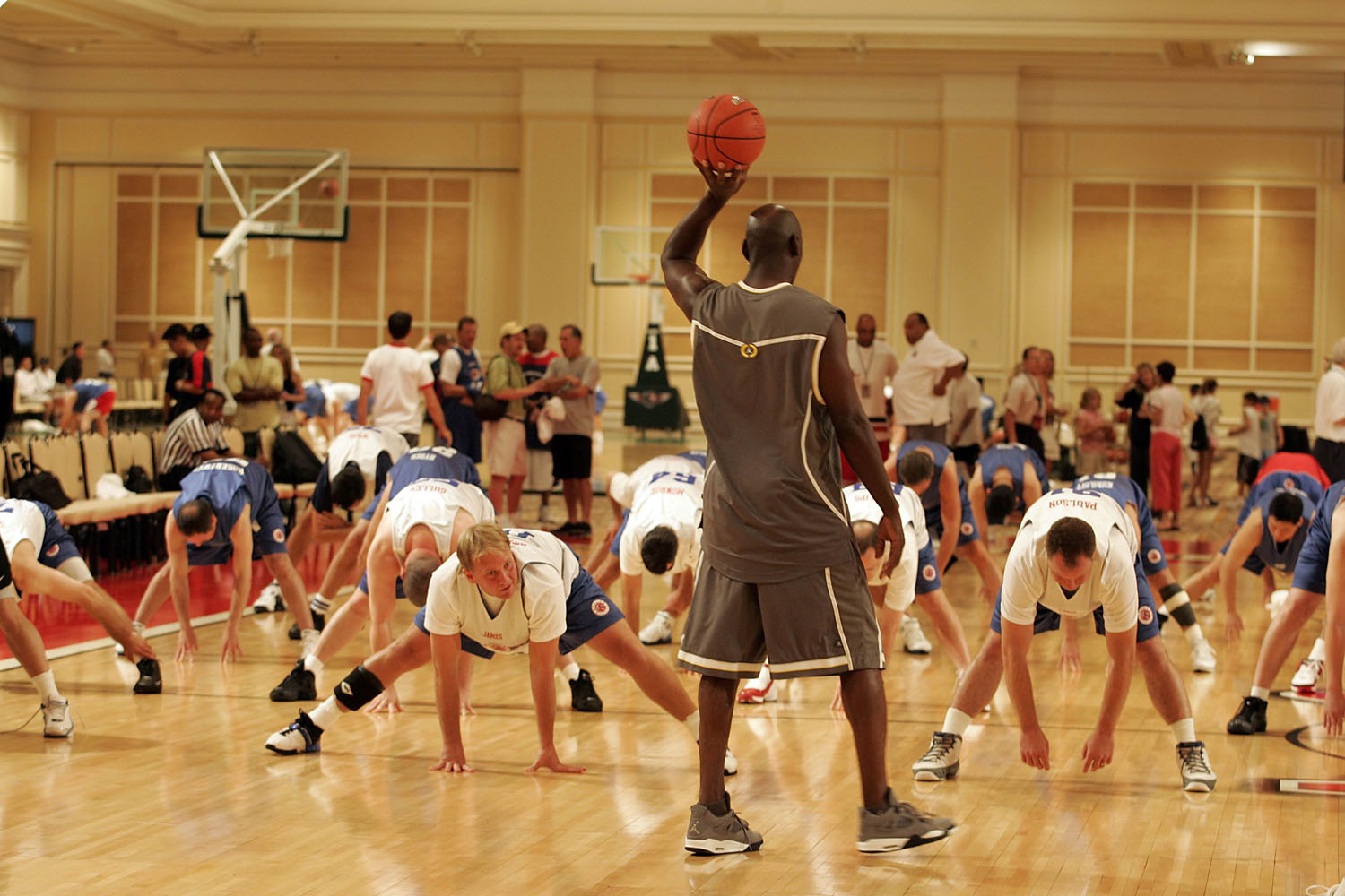 "Former NBA superstar Michael Jordan talks with ""campers"" who are stretching out prior to practice at the Michael Jordan Senior Flight School at The Mirage Hotel and Convention Center in Las Vegas in 2004."