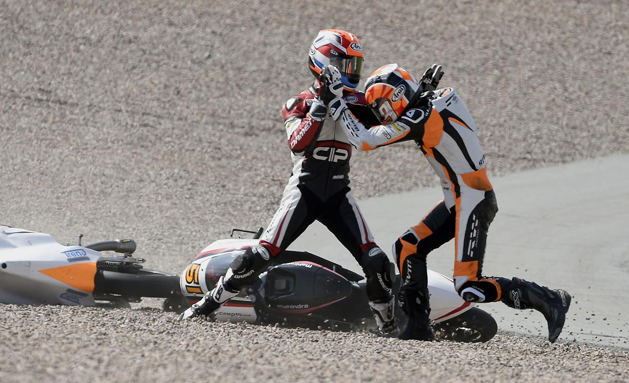 Bryan Schouten and Scott Deroue, who both happen to be from the Netherlands, express their displeasure at running into each other during a race at the Sachsenring circuit in Hohenstein-Ernstthal, Germany.