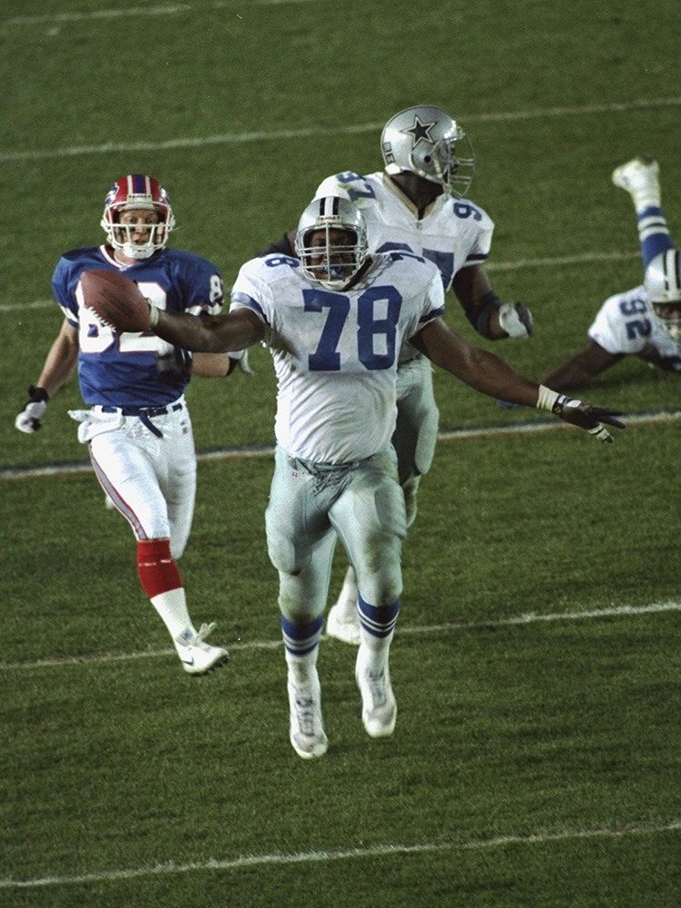 You can't blame Leon Lett for wanting to celebrate. His Dallas Cowboys were blowing out the Buffalo Bills 52-17 when the defensive tackle scooped up a fumble with a clear path to the end zone. But maybe he should have waited until he actually scored to start celebrating. Instead, he slowed down and held the ball to his side, allowing Bills wide receiver Don Beebe to run him down and knock it out of his hand. Lett didn't get his touchdown, but the Cowboys' win was a nice consolation.