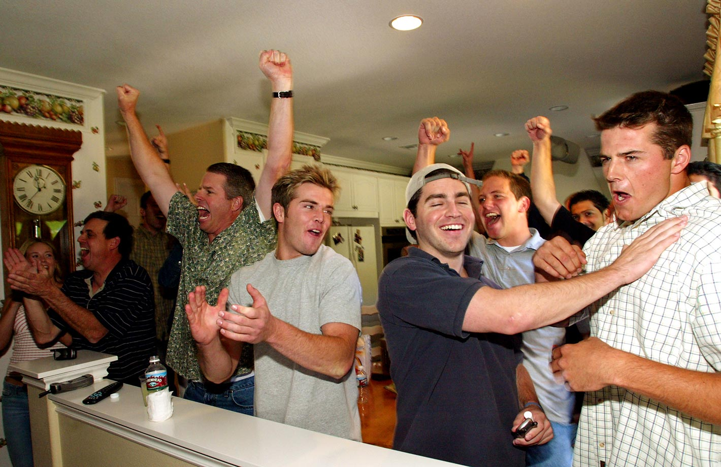 California quarterback Kyle Boller, far right, reacts as he learns that he has been drafted 19th by the Baltimore Ravens in the 2003 draft.