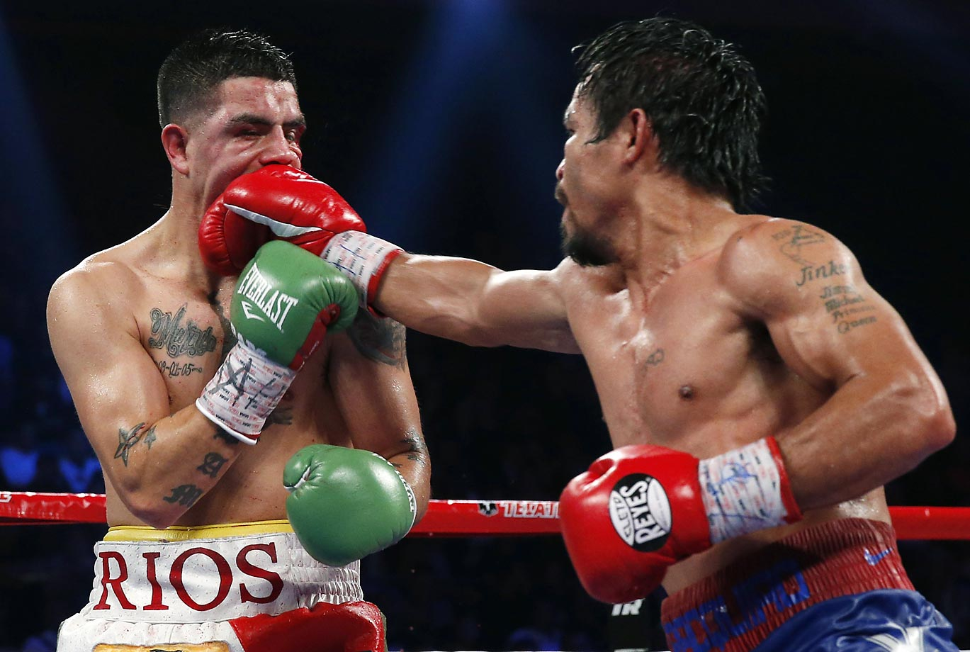 Manny Pacquiao lands a right to Brandon Rios during their WBO international welterweight title fight Nov. 24, 2013, in Macau, China. Pacquiao defeated Rios by unanimous decision to end a two fight losing streak.