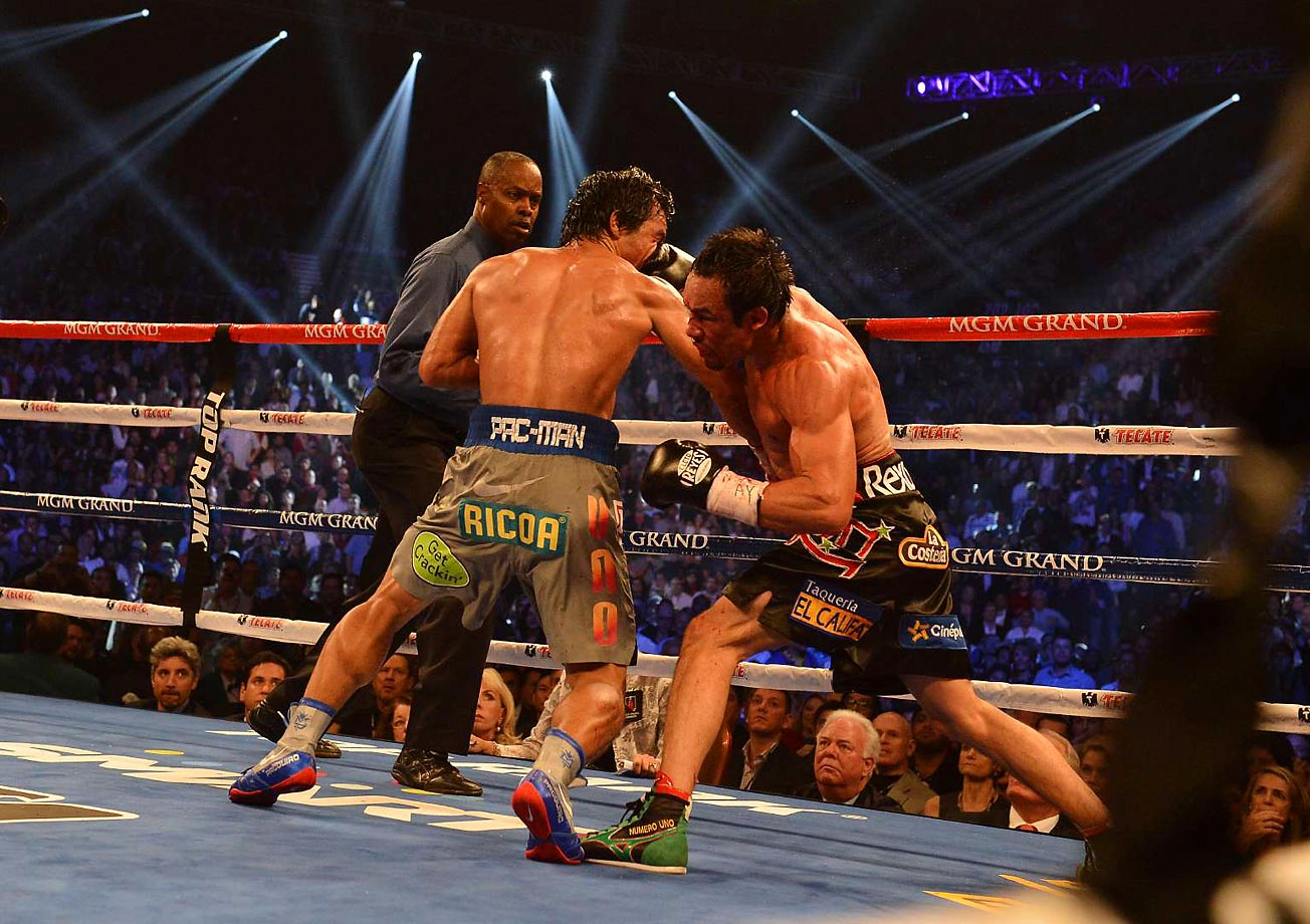 In his fourth meeting with Juan Marquez, Pacquiao was knocked out in the sixth round, marking the first time in his career he'd lost consecutive bouts.