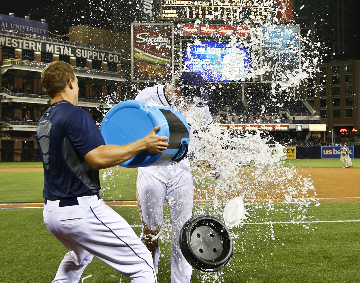 Andrew Cashner is doused by teammate Nick Hundley after throwing a one-hitter in the Padres 6-0 win over the Tigers.