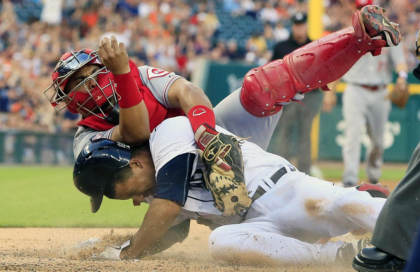 Anthony Gose of the Detroit Tigers is tagged out by Brayan Pena of the Cincinnati Reds.