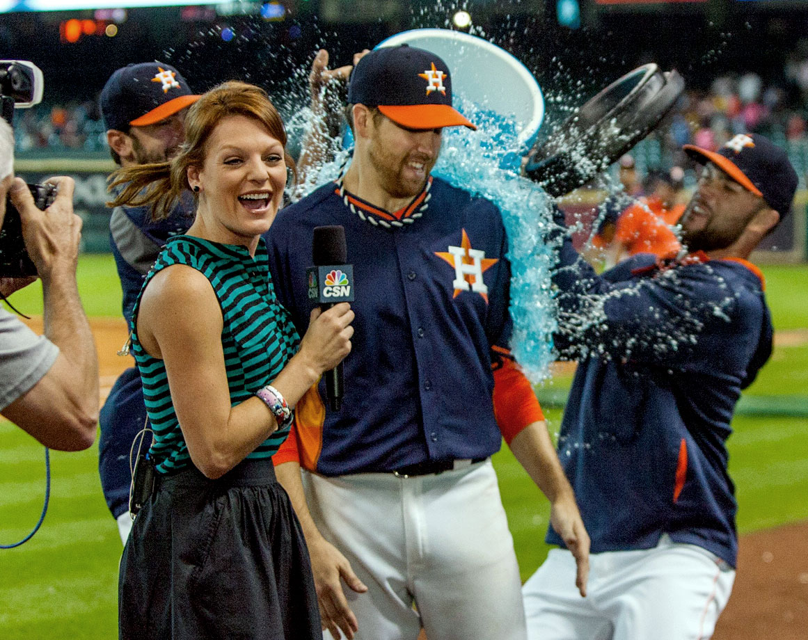 Collin McHugh is doused by teammate Dallas Keuchel after allowing just two hits over eight innings in the Astros 5-1 win over the A's.