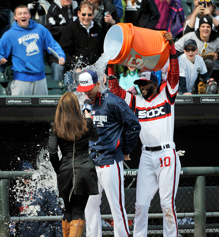Scott Carroll is doused by teammate Alexei Ramirez after earning the win in his major league debut with the White Sox, who defeated the Rays 9-2.