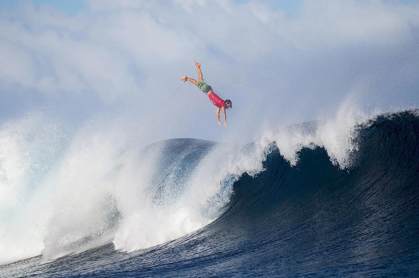 Julian Wilson flying through the air after pulling out of a wave at the last minute during the World Surf League Fiji Pro.