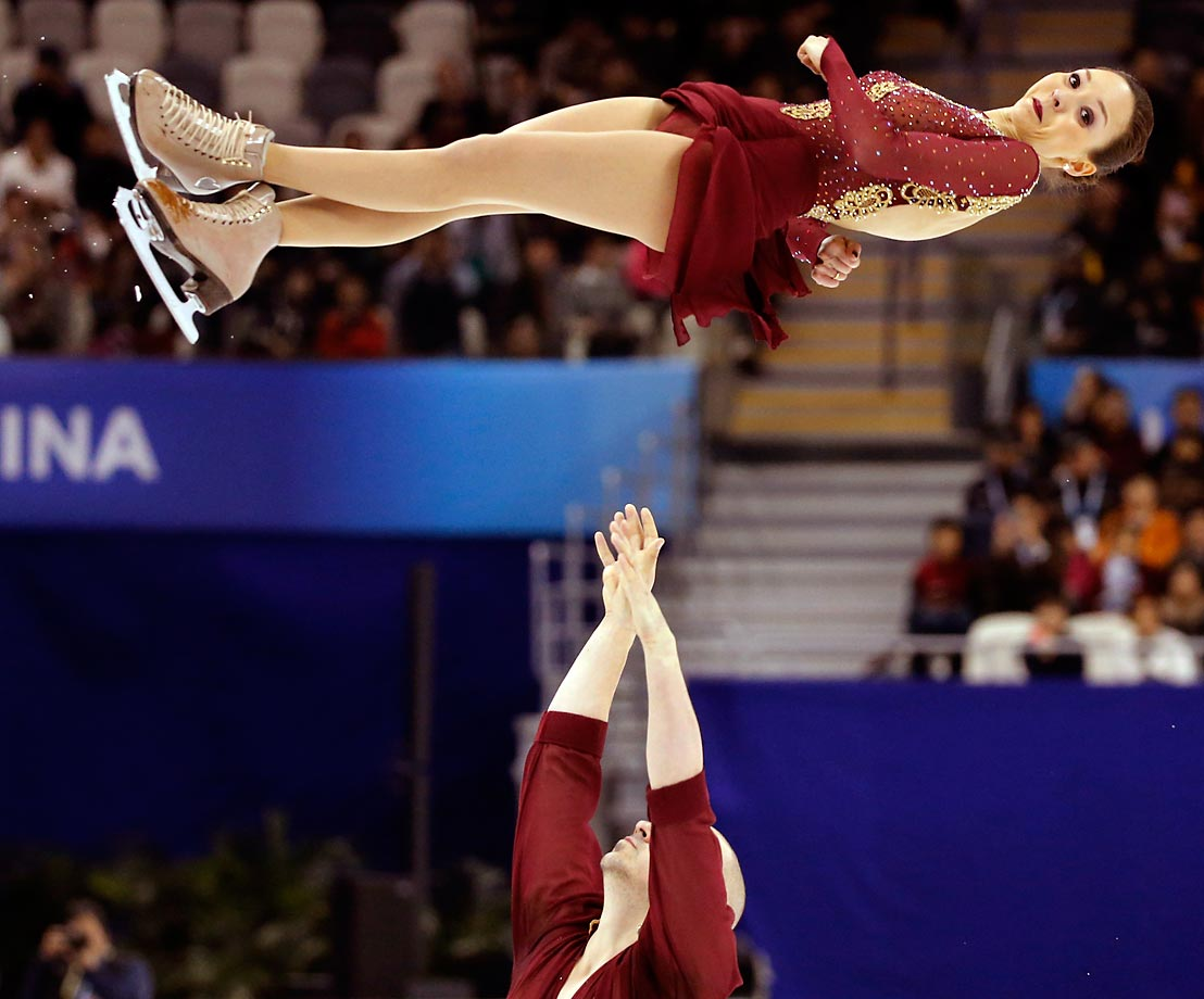 German figure skater Mari Vartmann flies from the arms of her partner Aaron Van Cleave at the ISU World Figure Skating Championship in Shanghai.