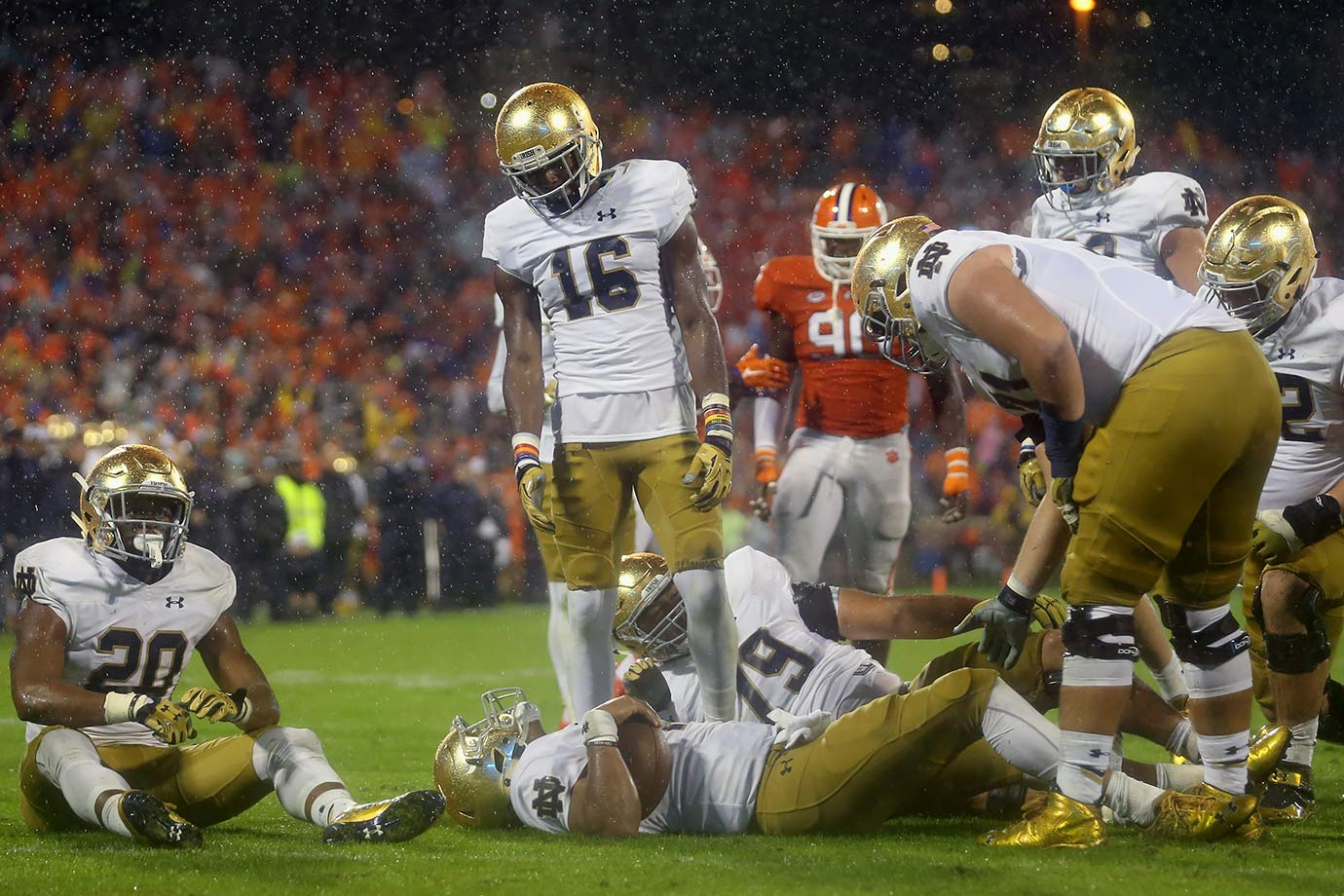 "Clemson solidified its status as a playoff contender by surviving Notre Dame—and hurricane-like elements—in a soggy Death Valley. The Fighting Irish whittled the Tigers' 17-point, fourth-quarter lead to two on a Deshone Kizer touchdown pass with seven seconds to play. But defensive tackle Carlos Watkins stuffed Kizer on Notre Dame's two-point conversion attempt, maintaining Clemson's unblemished record. As coach Dabo Swinney bellowed in his postgame interview, it was a ""Bring your own guts"" victory."