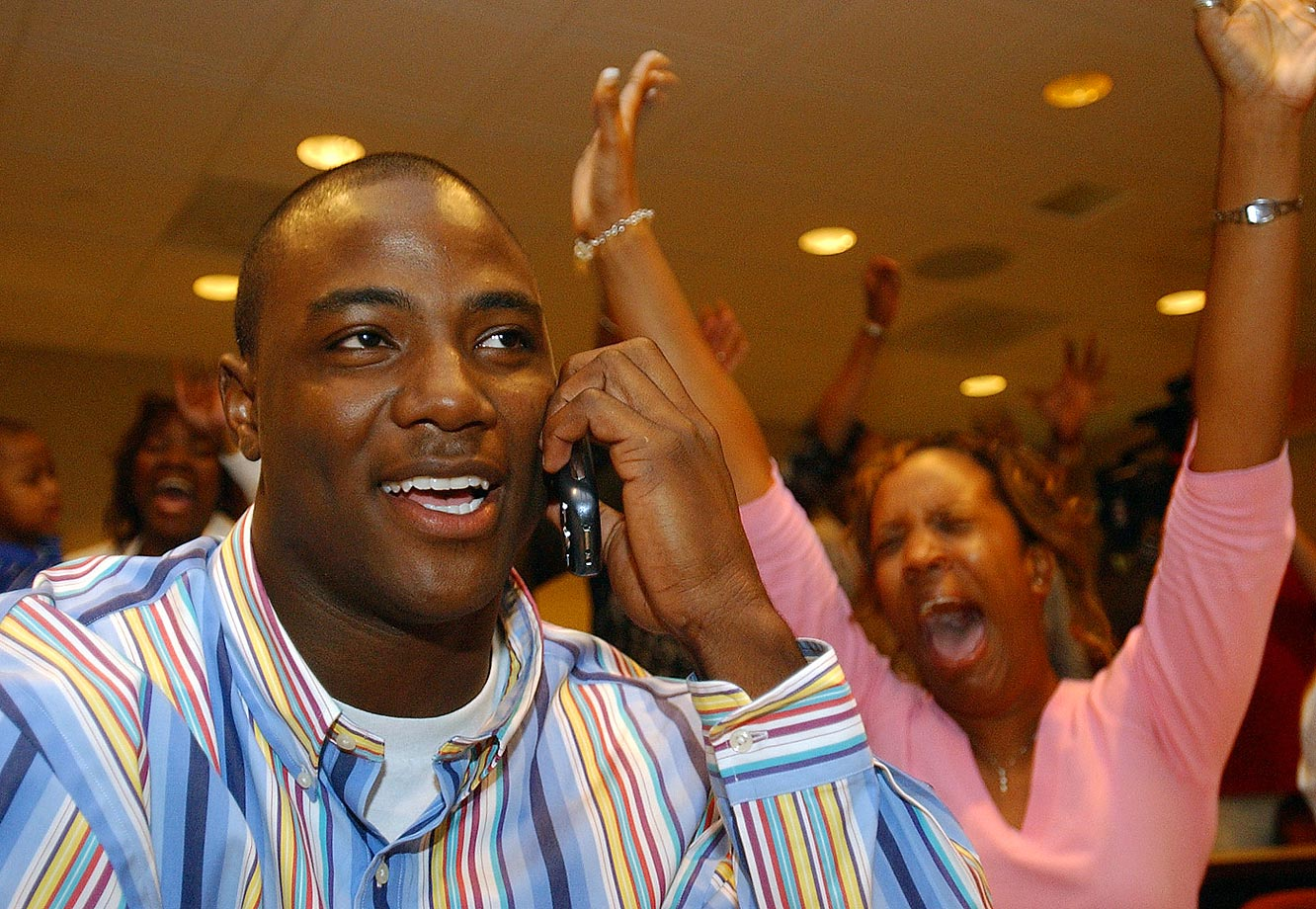 Troy defensive end DeMarcus Ware, seated next to his fiancee, reacts to news that the Dallas Cowboys had selected him in the first round of the 2005 draft.