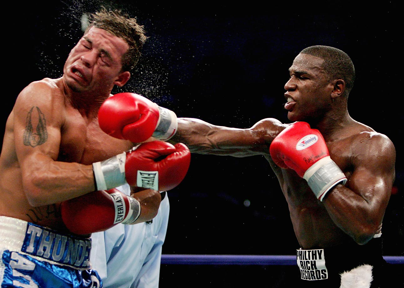 Mayweather won a world title in a third different weight class -- this time at 140 pounds -- with an obliteration of Gatti in six rounds in Atlantic City, N.J.