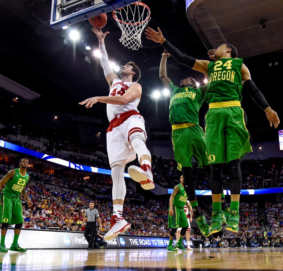 The Badgers nearly lost to Oregon in the Round of 32, and now the blueprint for beating them is out there. If you double Frank Kaminsky in the post, you make him uncomfortable and disrupt the Badgers' offensive flow. One of these remaining teams will be able to do that, and do more on the offensive end than the Ducks could to knock off the Badgers. (Text credit: Michael Beller)