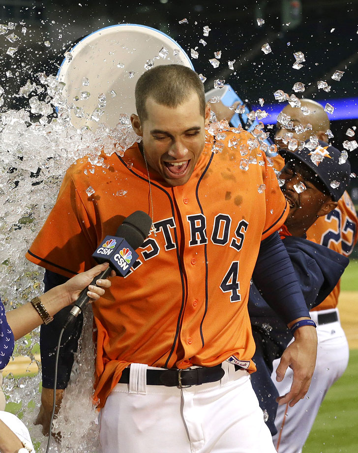 George Springer is doused by teammates after knocking in the game-winning run with an RBI single in the 11th inning of the Astros 5-4 win over the Mariners.