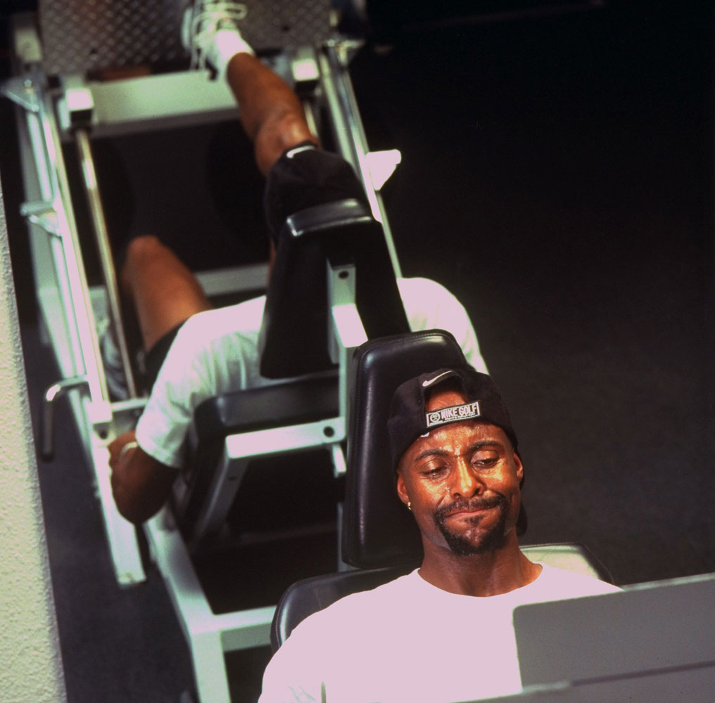 San Francisco 49ers wide reciever Jerry Rice working out with the leg press machine as part of his rehabilitation from knee injury in December 1997.