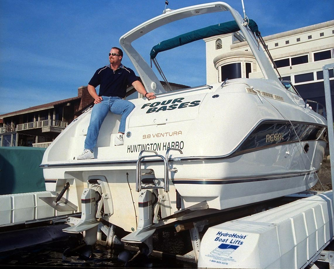 In the January before he captivated the baseball world by breaking Roger Maris' home run record, McGwire sits on his boat in Huntington Harbor, Calif.