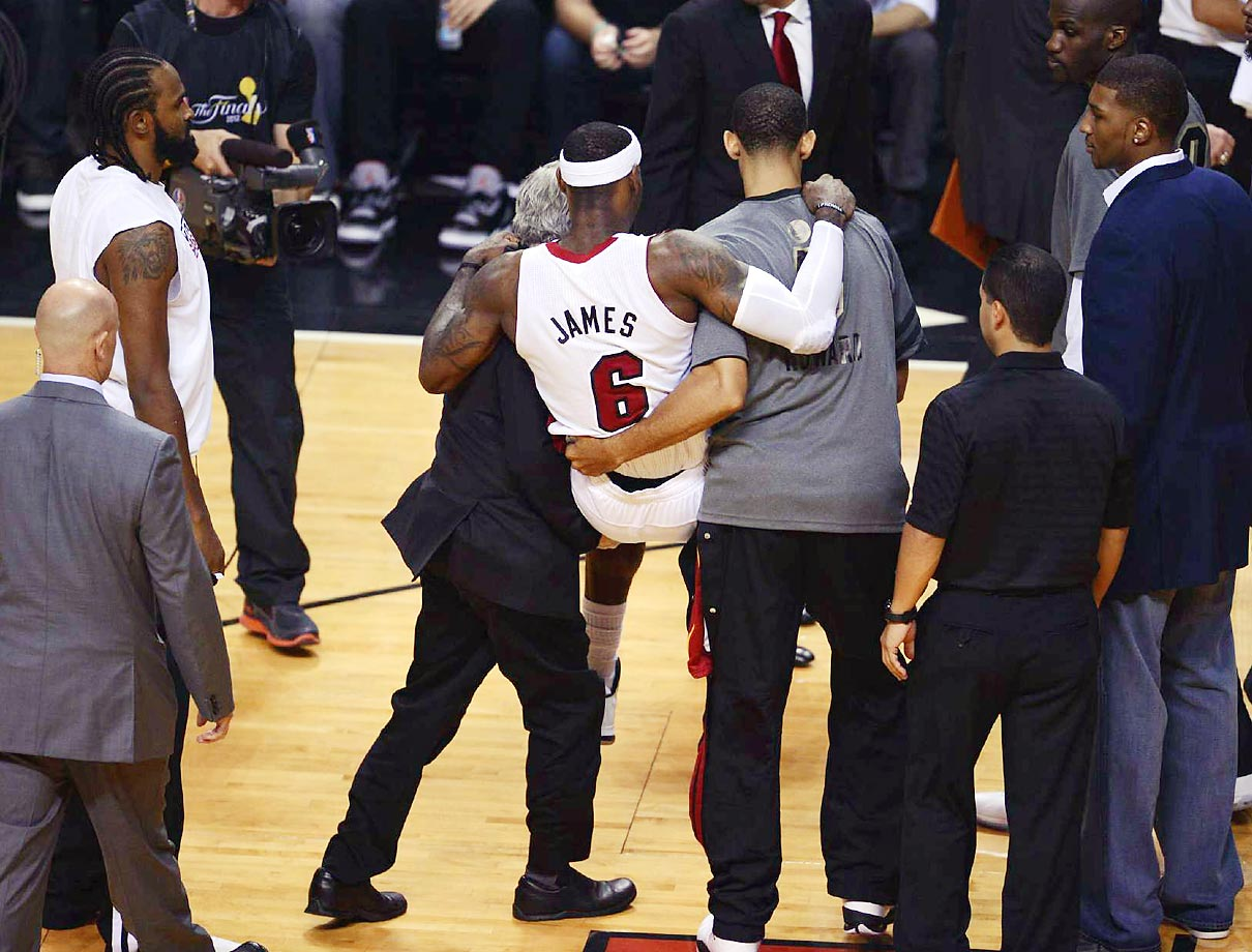 LeBron James battled cramps in Game 4 and was unable to finish out a 104-98 Heat victory. He still had 26 points, nine rebounds and 12 assists.
