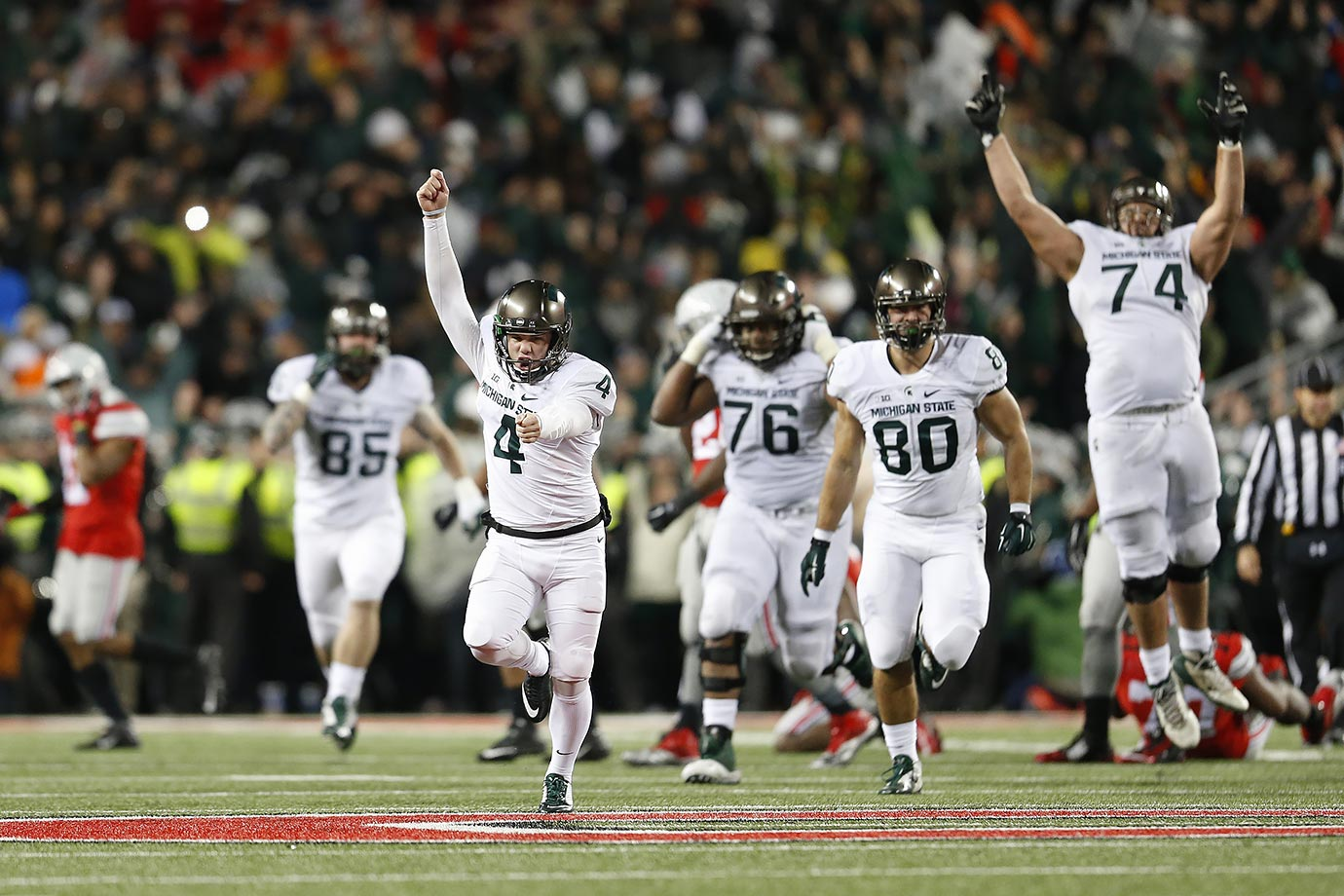 The Spartans, playing without an injured Connor Cook, came into Columbus and took down the undefeated Buckeyes on a 41-yard field goal from Michael Geiger as time expired to end Ohio State's 23-game winning streak. (Geiger's boot and windmill celebration made him a celebrity around East Lansing.) The win put Sparty in prime position to win the Big Ten East (which it later did), while essentially knocking the Buckeyes from College Football Playoff contention. Michigan State also shut down star running back Ezekiel Elliott, who rushed only 12 times for 33 yards and voiced his unrest afterward with Urban Meyer and the coaching staff's game plan.