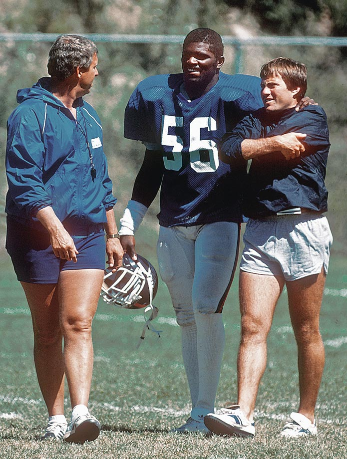 Hall of Fame Giants linebacker Lawrence Taylor chats with coaches (and short-shorts committee members) Bill Parcells and Bill Belichick in 1986. That season, Taylor would be named the NFL MVP and the Giants would defeat the Broncos to win their first ever Super Bowl.