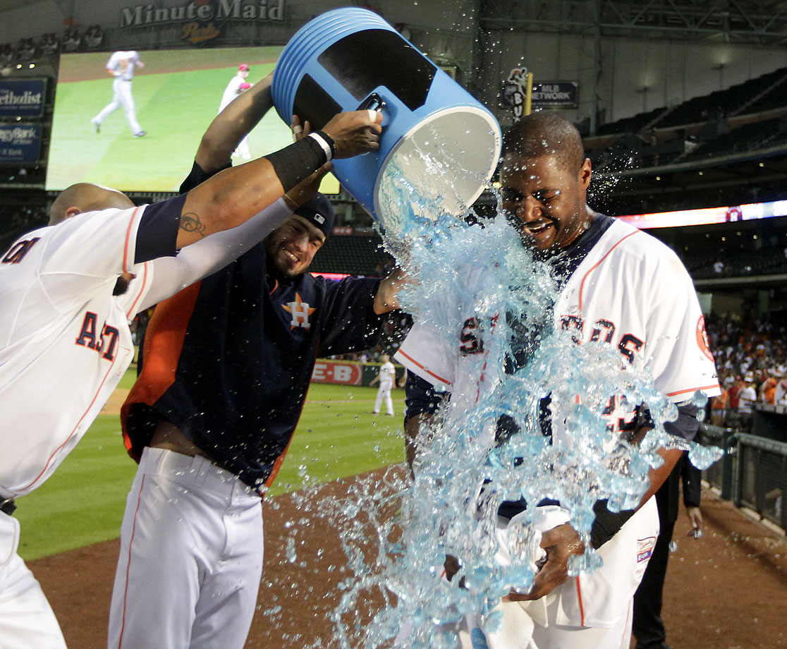 Chris Carter is doused by teammates Jon Singleton and Jarred Cosart after homering to lead off the bottom of the 10th inning in the Astros 5-4 win over the Diamondbacks.
