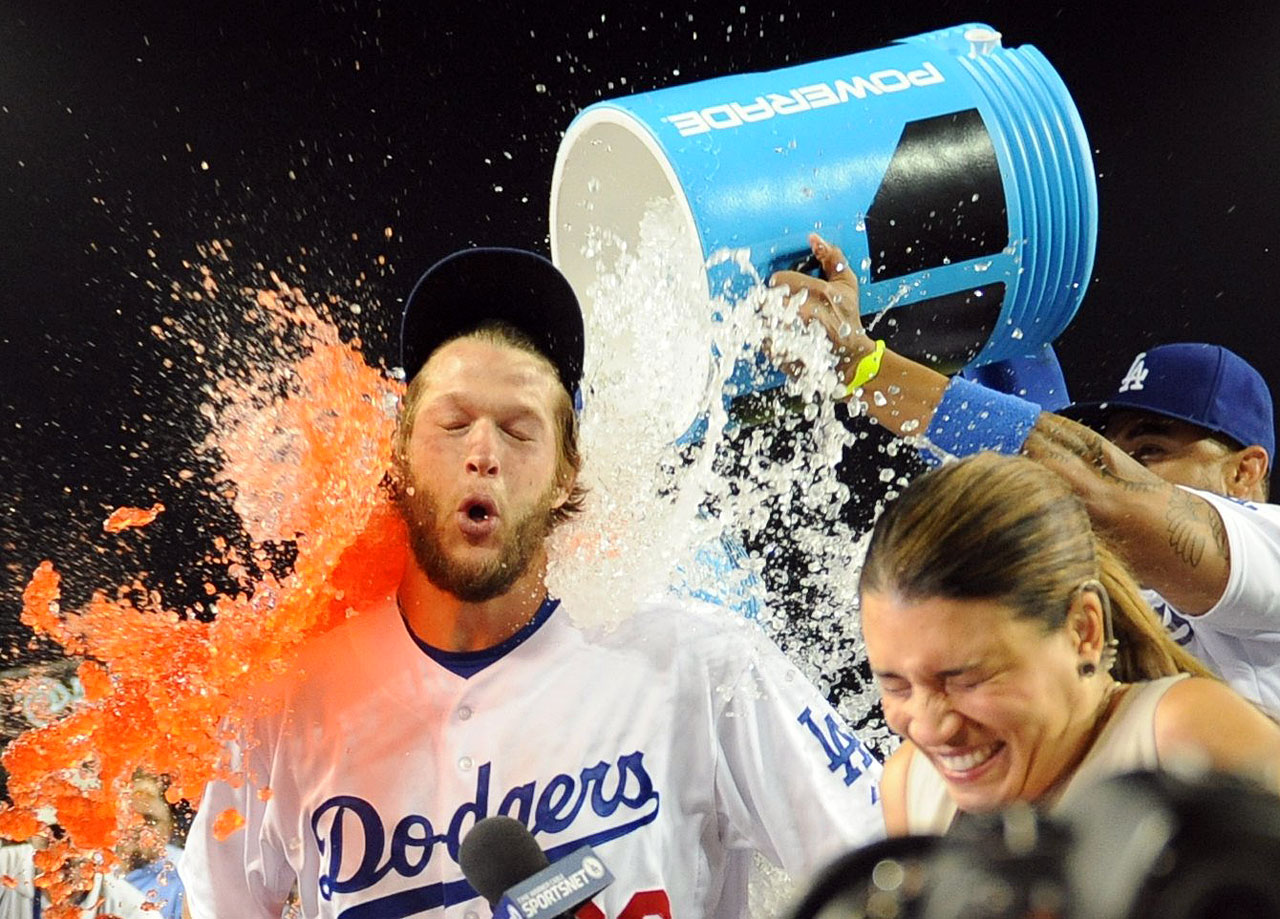 Clayton Kershaw is doused by teammate Matt Kemp after throwing his first career no-hitter in the Dodgers 8-0 win over the Rockies.