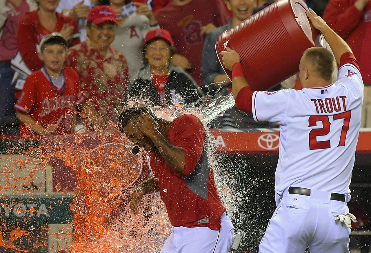Howie Kendrick is doused by teammate Mike Trout after hitting a game-winning RBI double in the bottom of the 10th inning of the Angels 3-2 win over the Rangers.