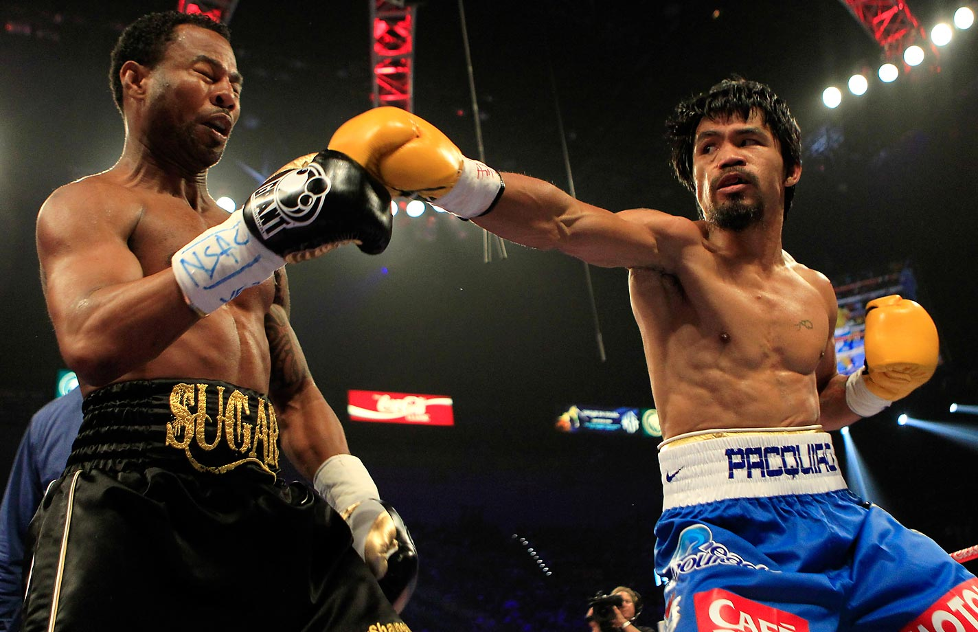 Pacquiao wasn't up to his near-perfect standard, but he still dominated the 39-year-old Mosley over 12 rounds for a unanimous-decision win. Trainer Freddie Roach said Pacquiao, who was involved in a fight-day fender bender, was beset by leg cramps during the fight. Mosley suffered just the third knockdown of his career in the third round and, by the end of an uninspiring fight, was being booed by the Vegas crowd.