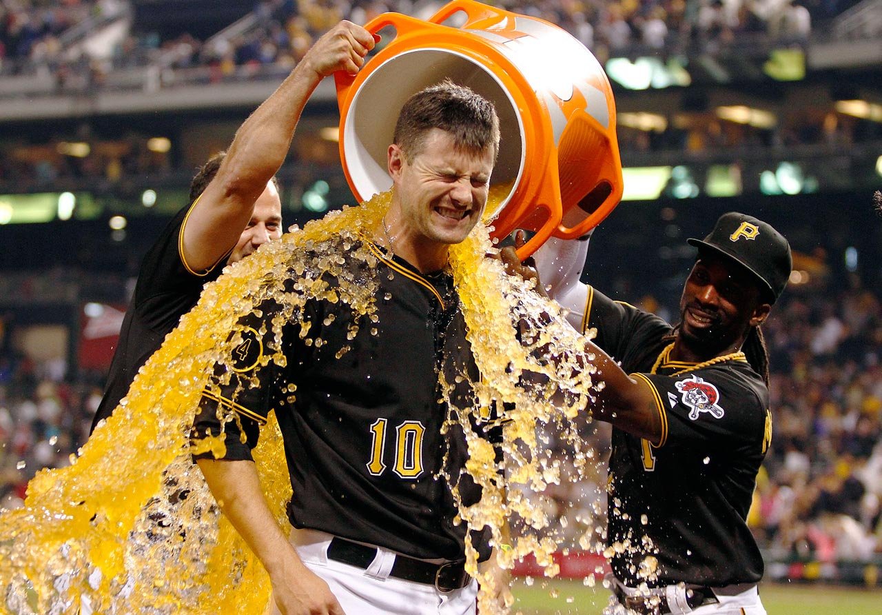 Jordy Mercer is doused by teammates Gaby Sanchez and Andrew McCutchen after hitting a walk-off double in the 11th inning of the Pirates 3-2 win over the Rockies.