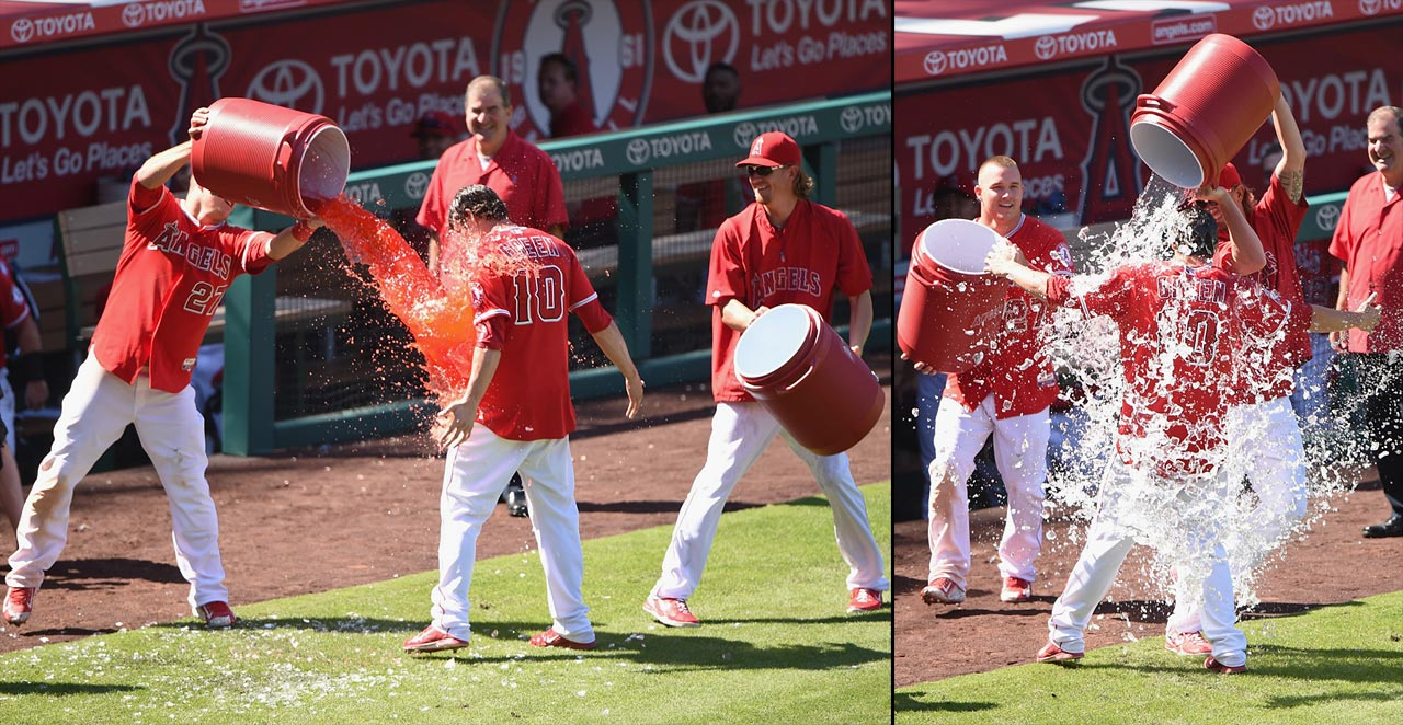 Grant Green is doused by teammates Mike Trout and Jered Weaver after knocking in the winning run with a base hit in the ninth inning of the Angels 6-5 win over the Mariners.
