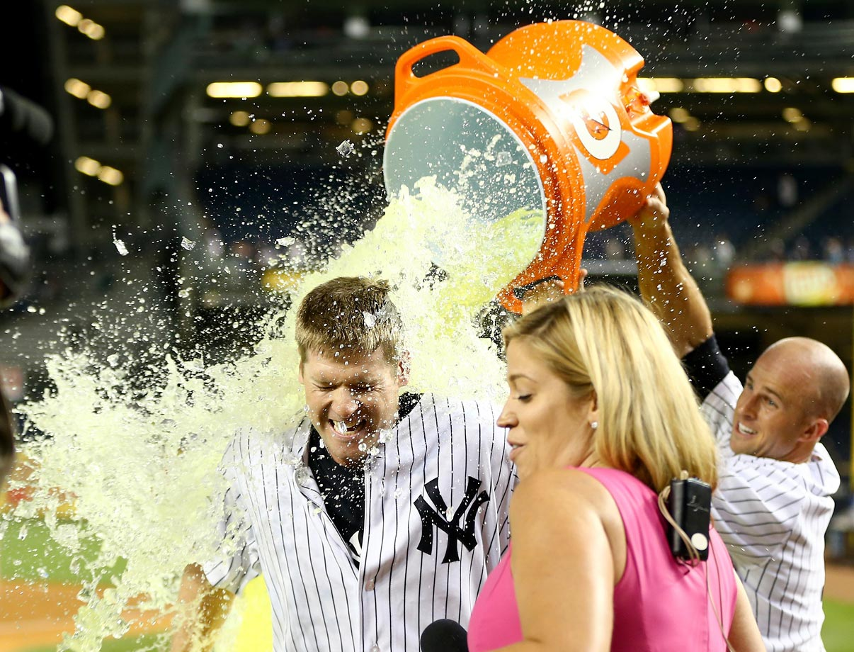 Chase Headley is doused by teammate Brett Gardner after hitting a game-winning single in the 14th inning of the Yankees 2-1 win over the Rangers.  It was Headley's first game with New York after just being traded by the Padres.