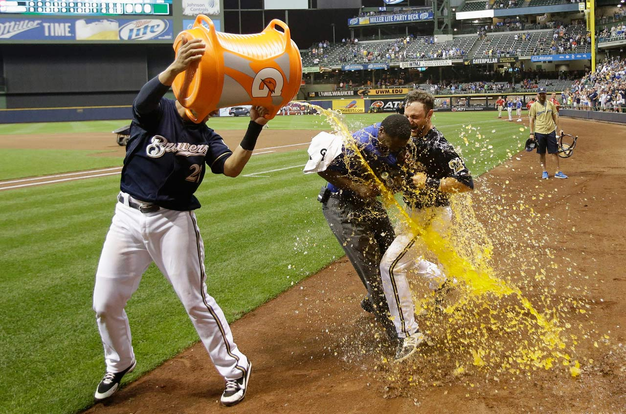 Jonathan Lucroy is doused by teammate Carlos Gomez after hitting a walk-off solo home run in the ninth inning of the Brewers 4-3 win over the Reds.  It was Lucroy's second homer of the game.
